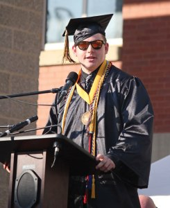 Woodland Regional High School Class of 2016 Valedictorian Zach Crowell looks over the crowd as he delivers the valedictorian address during graduation June 16 at the school in Beacon Falls. –ELIO GUGLIOTTI