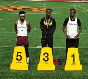 Naugatuck's Fejiro Onakpoma, right, and Antoine Sistrunk, left, are pictured at the New England track and field championship Saturday at Veteran's Stadium in New Britain. Onakpoma won the triple jump title and Sistrunk took fifth in the event. –CONTRIBUTED