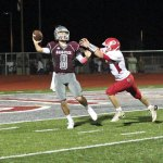 Naugatuck's Michael Plasky (8) throws a pass under pressure from Derby's Tom Abel Sept. 9 in Naugatuck. Naugatuck won the game, 44-21. –ELIO GUGLIOTTI