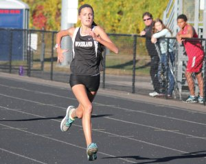 Woodland's Emma Slavin sprints to the finish line Oct. 11 during a meet with Sacred Heart, Holy Cross and Derby in Beacon Falls. –ELIO GUGLIOTTI
