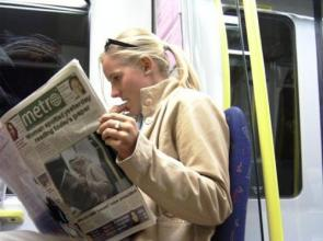 Woman Spotted yesterday reading today's paper