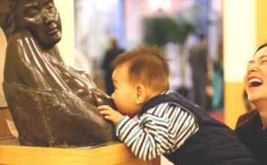 You're Doing it Wrong! ( baby nursing on statue)