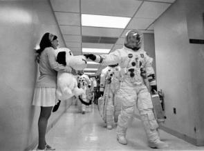 Cutie Holding Snoopy Greets Astronauts