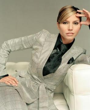 Carisma Carpenter In Suit On Chair