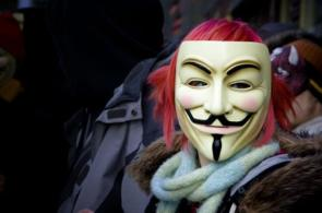 Anonymous In Action – Guy Fawkes Mask With Pink Hair