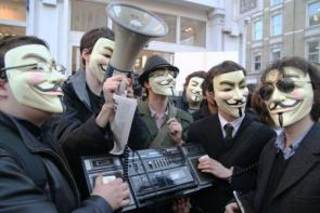 Anonymous In Action – Group Of Guy Fawkes Masks