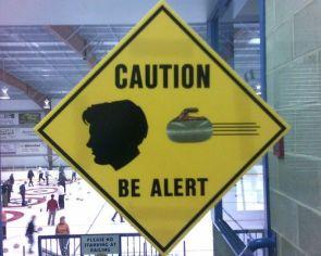 caution be alert – curling in progress