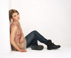 Julia Stiles Against a Wall