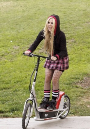 Avril Lavigne on an electric scooter