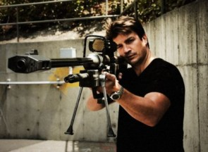 nathan fillion with halo sniper rifle