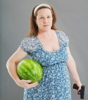 fat woman with watermellon and pistol