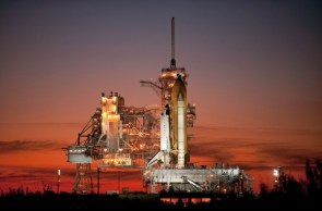 sts129-s sunset space-shuttle atlantis on launch pad wallpaper