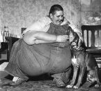 a very large man and his doggie