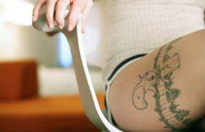 pistol leg tattoo