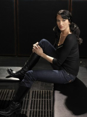 Claudia Black – sitting in jeans