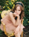 emma watson in a yellow chair