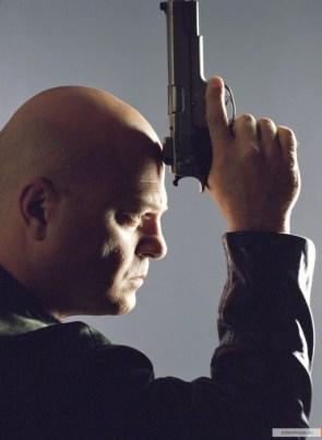 vic mackey with pistol forhead