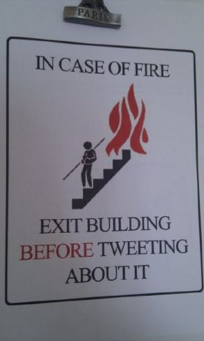 in case of fire – exit building before tweeting about it