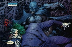 batman punches the joker