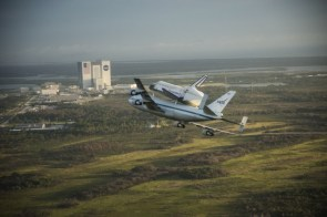 shuttle flying on top