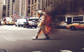 walking spaceman on fire