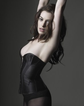 catwoman anne hathaway stretches and her boobs almost fall out