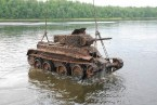 rusted up tank in a lake