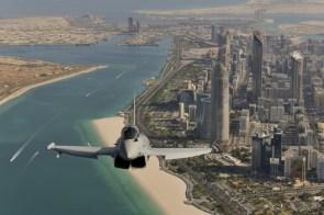 Plane over city