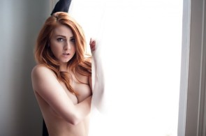 redhead by the window