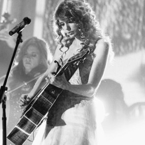 taylor plays guitar