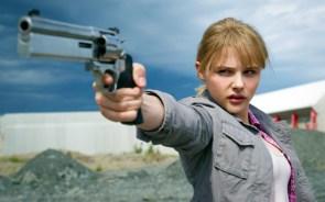 Chloe with a gun