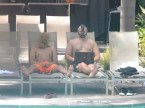 bane and scarecrow by the pool