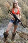Blonde Gunner in mud boots
