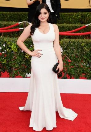 Ariel Winter in white dress looking forward