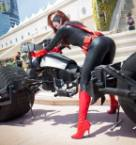 Batwoman on a bike