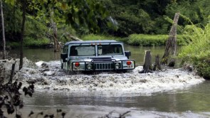 Hummer in the river