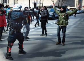 Montreal cop points grenade launcher at protester