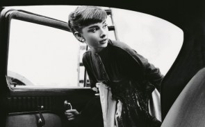 Audrey Hepburn entering a car