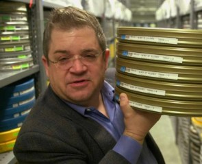 Patton Oswalt with some movie reels