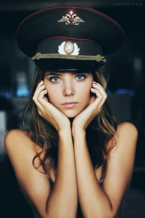 Girl in a military hat