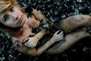 Nude girl in burnt flowers