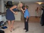 tall woman talking to short man