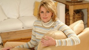 Amanda Tapping on a couch