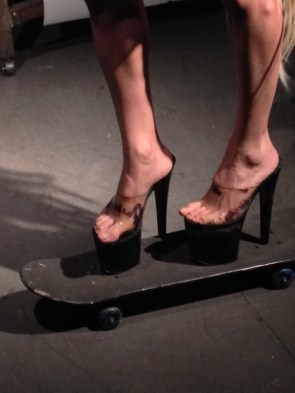 high heel skate boarder