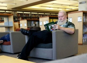 santa brushing up at the library