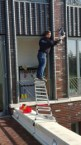 Using a ladder to change a bulb