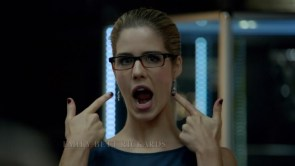 Felicity points to her mouth