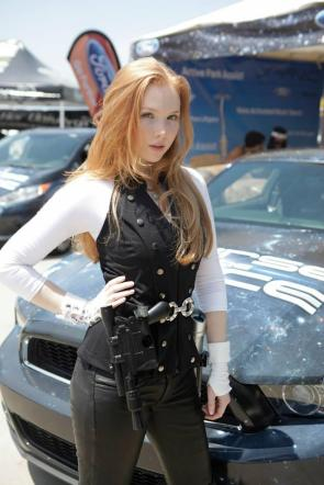 Molly Quinn with gun and sports car