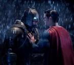 Superman shoving Batman