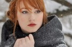 Red head in a hood in the snow